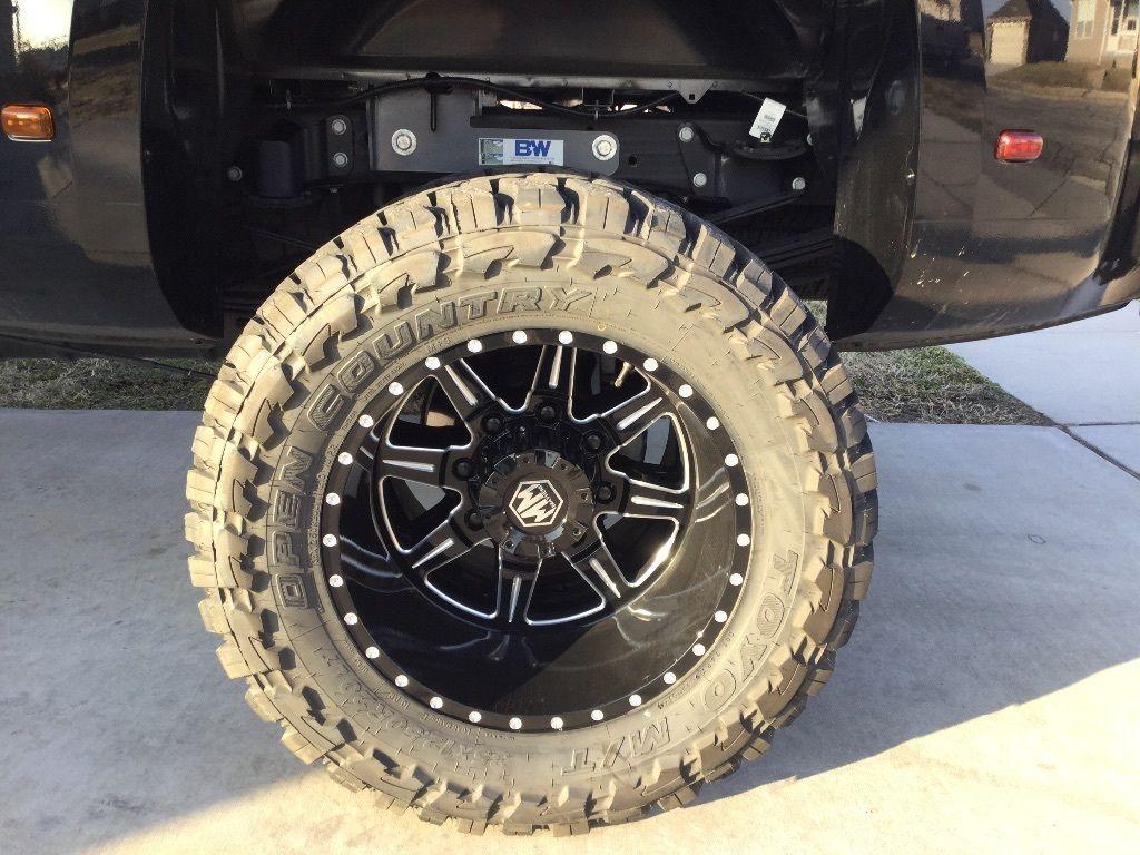 All black 2016 GMC Sierra 3500 Denali Lifted Dually