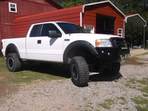 Customized 2007 Ford F 150 lifted with camper top for sale