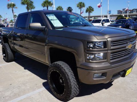 Decent mileage 2014 Chevrolet Silverado 1500 LT lifted truck for sale