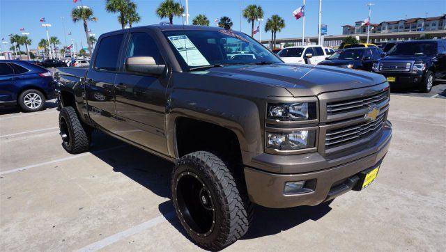 Decent mileage 2014 Chevrolet Silverado 1500 LT lifted truck for sale