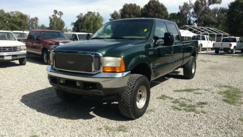 Green beast 2001 Ford F 250 Lariat lifted truck
