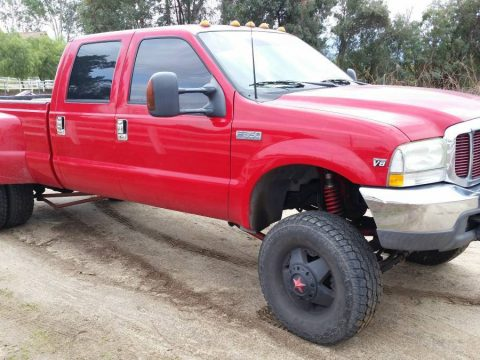 Red monster 1999 Ford F 350 lifted truck for sale