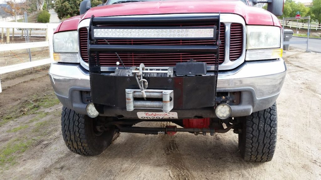 Red monster 1999 Ford F 350 lifted truck