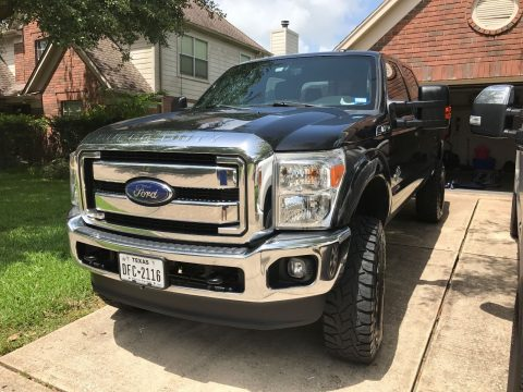 Super clean 2014 Ford F 250 lariat lifted for sale
