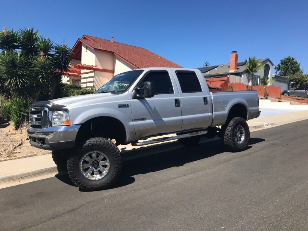 very clean 2001 Ford F 250 XLT lifted