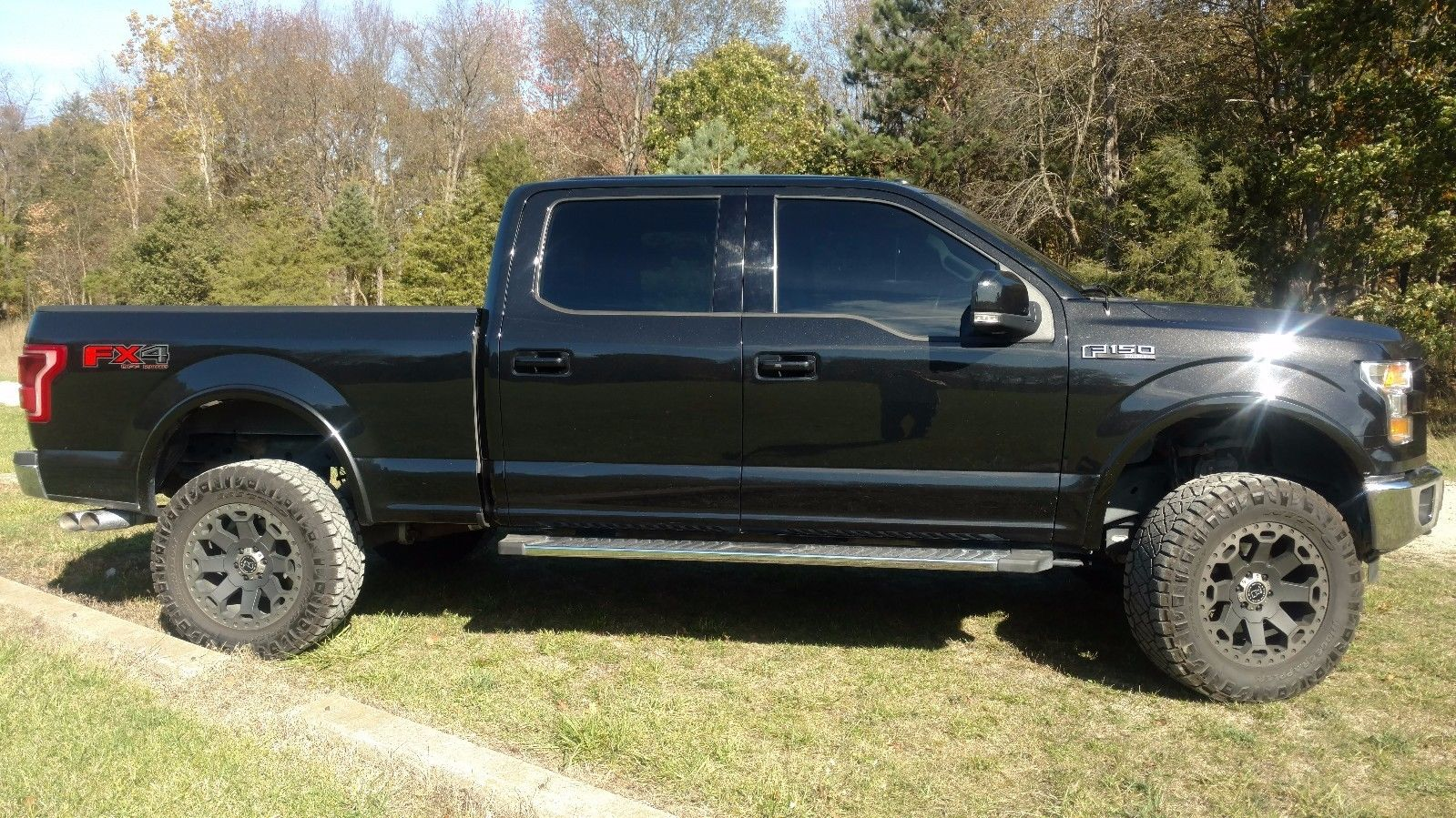 low miles 2015 Ford F 150 Lariat lifted