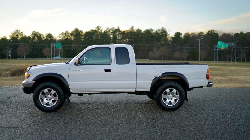 new tires and wheels 2002 Toyota Tacoma lifted