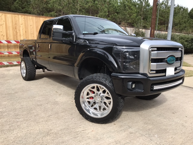 nicely customized 2015 Ford F 250 Platinum lifted for sale