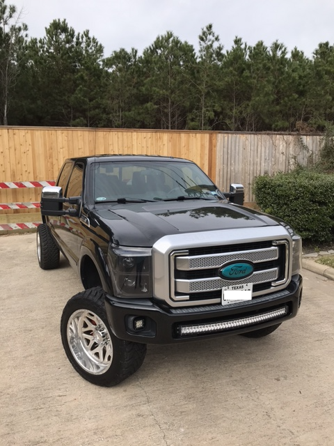 nicely customized 2015 Ford F 250 Platinum lifted