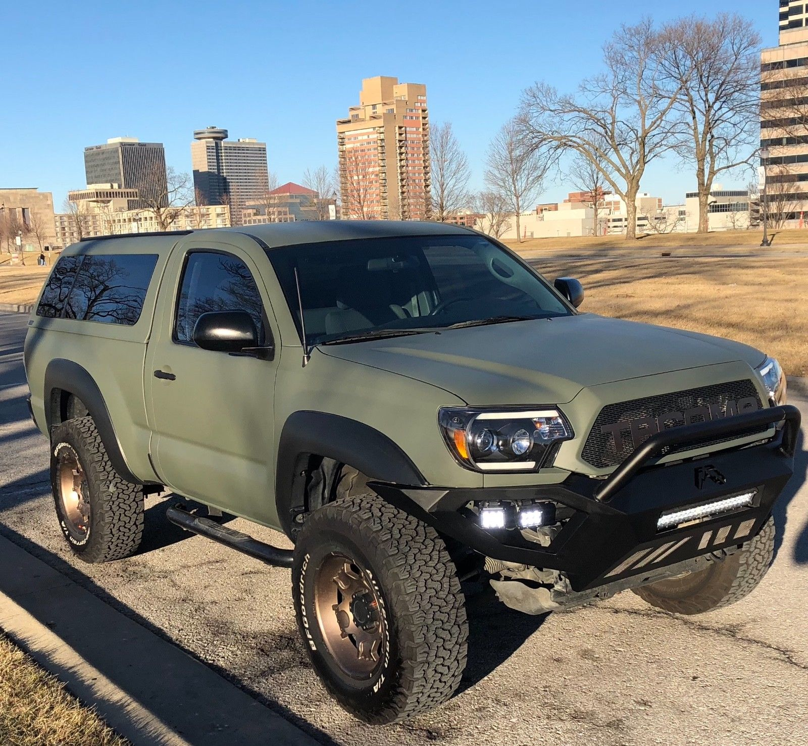 camper shell 2012 Toyota Tacoma lifted for sale