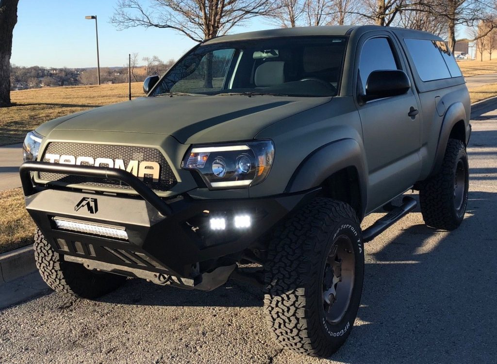 camper shell 2012 Toyota Tacoma lifted