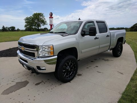 repaired 2013 Chevrolet Silverado 2500 LT lifted for sale