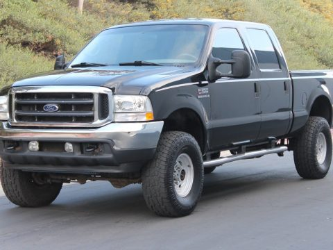 short bed 2002 Ford F 350 Lariat CREW CAB lifted for sale