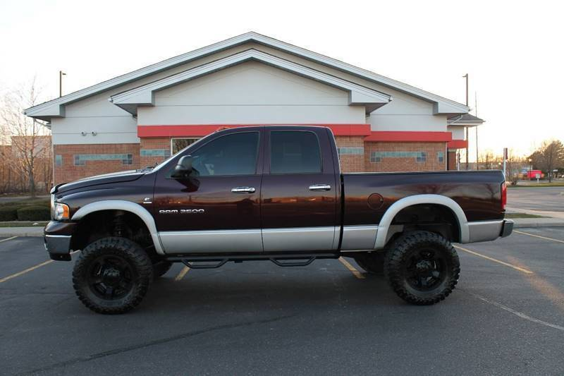 very clean 2005 Dodge Pickups SLT 4dr Quad Cab 4WD lifted