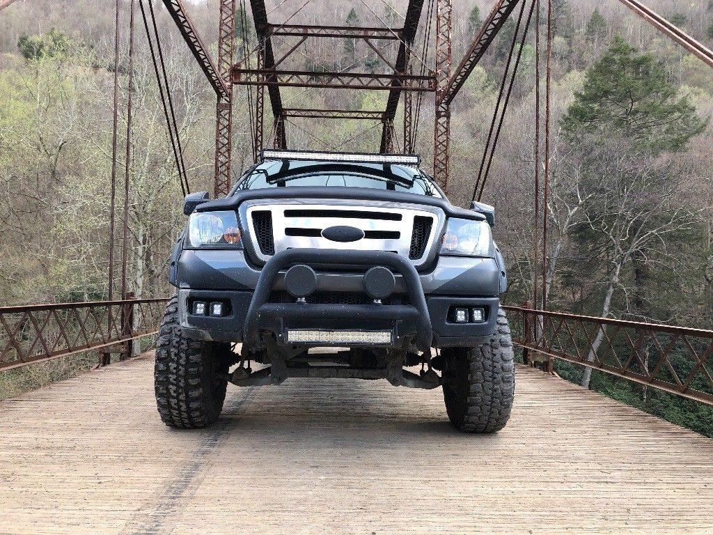 some additions 2004 Ford F 150 FX4 Super Cab lifted