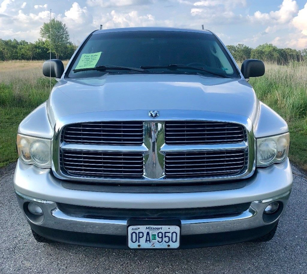 some dings 2004 Dodge Ram 2500 SLT lifted for sale