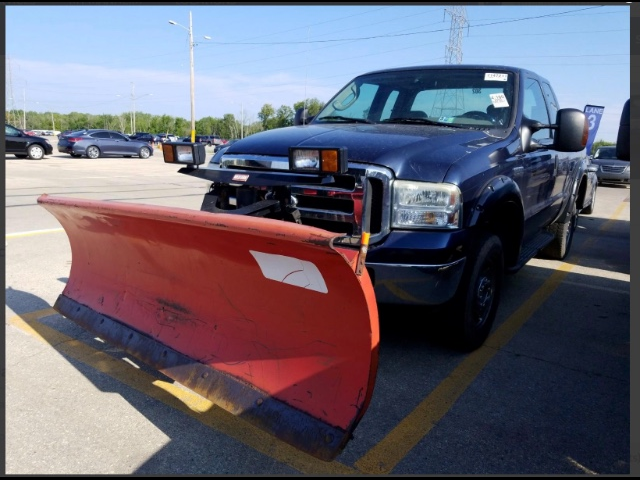 snow plow equipped 2005 Ford F 250 XLT Supercab Long Bed lifted truck