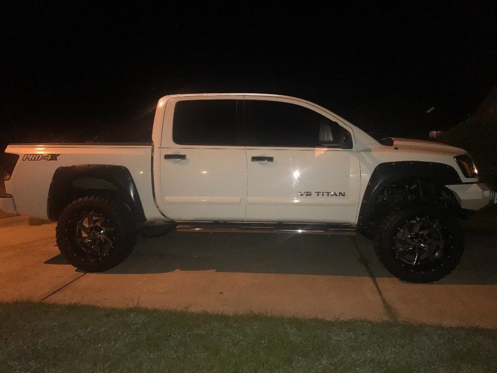 upgraded 2013 Nissan Titan PRO lifted pickup