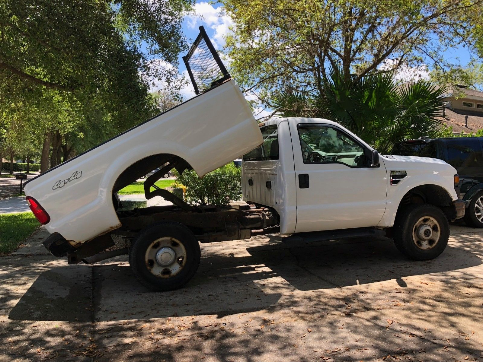 rusty 2008 Ford F 250 XL pickup lifted