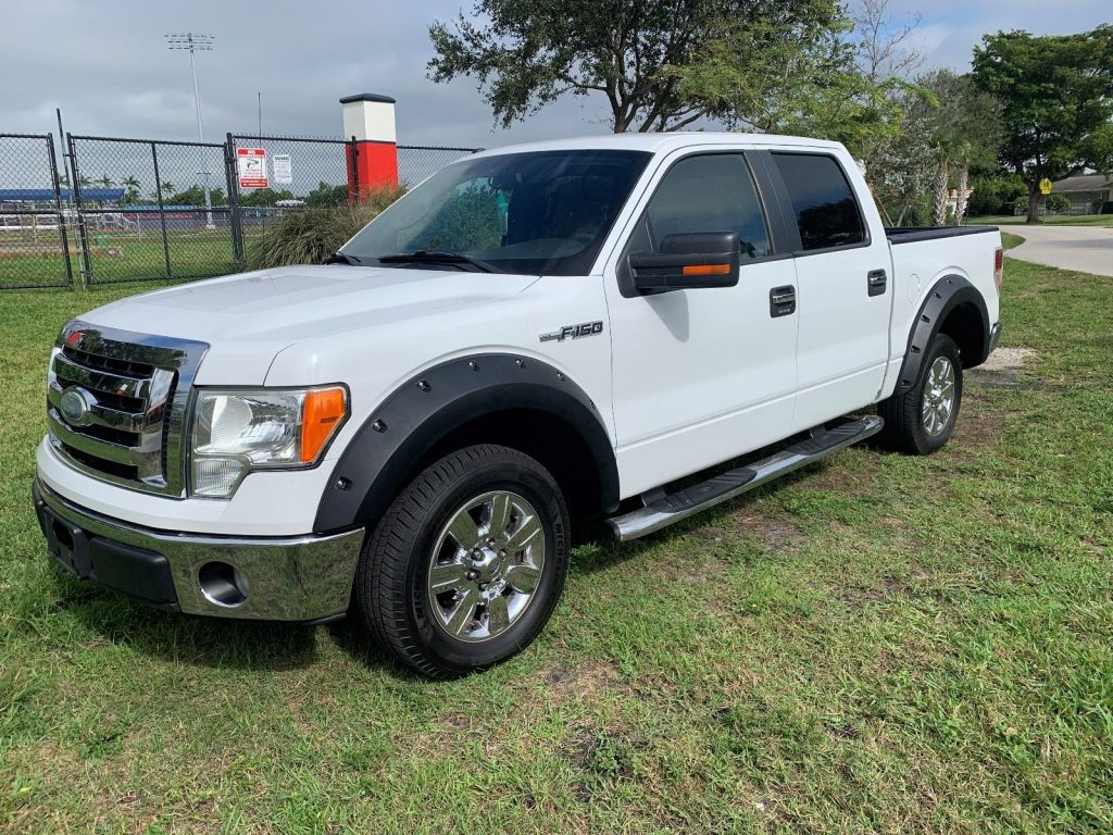 great shape 2009 Ford F 150 XLT lifted