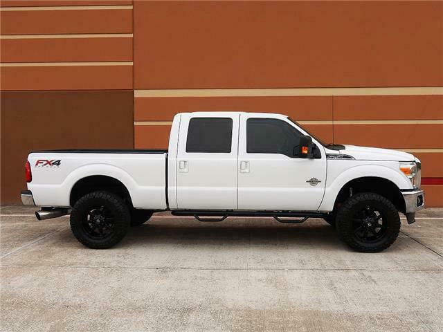 well equipped  2012 Ford F 250 Lariat pickup lifted