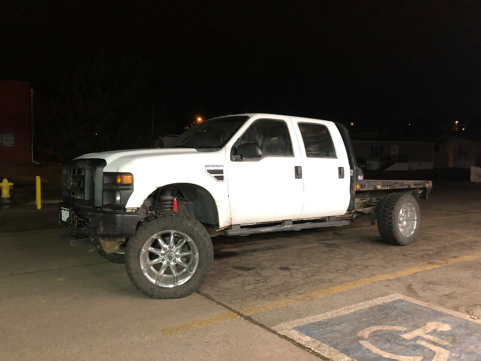 runs fantastic 2008 Ford F 350 flatbed lifted for sale
