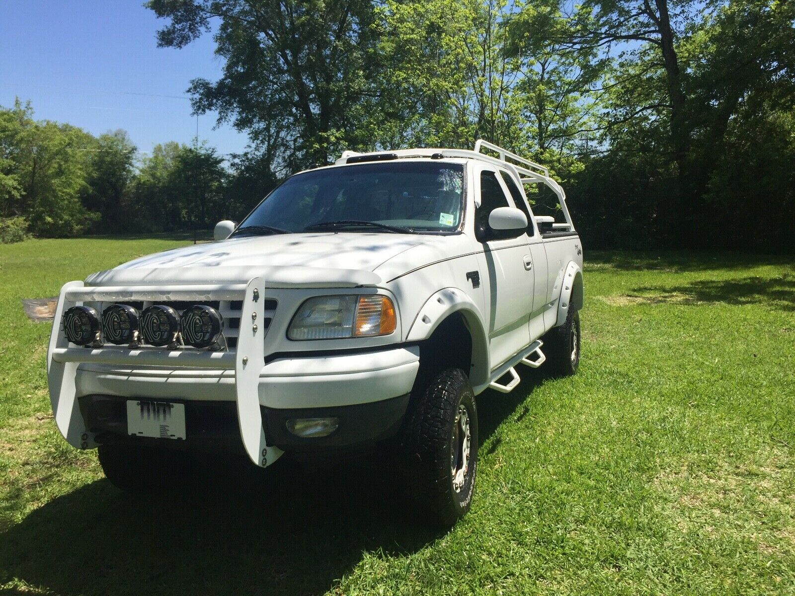 custom 2002 Ford F 150 pickup lifted for sale