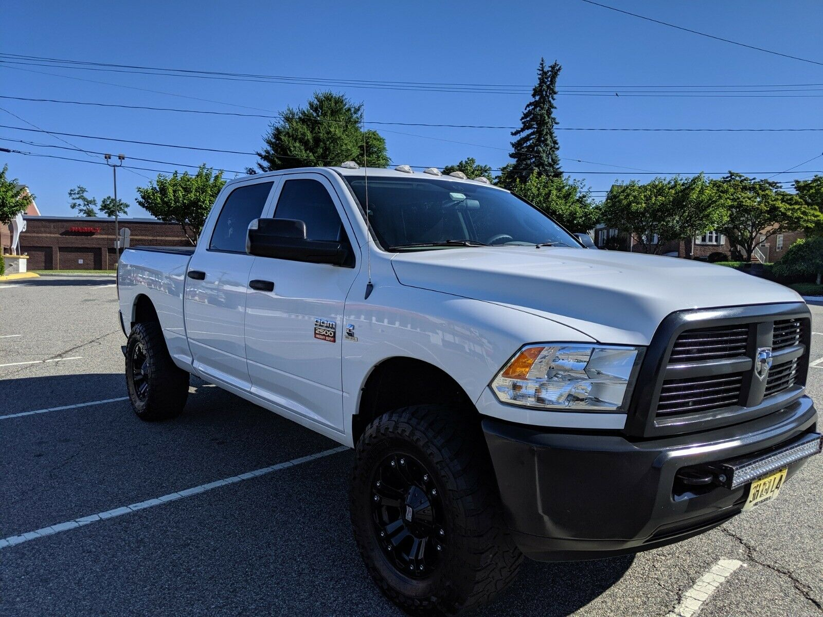 low miles 2012 Dodge Ram 2500 ST lifted