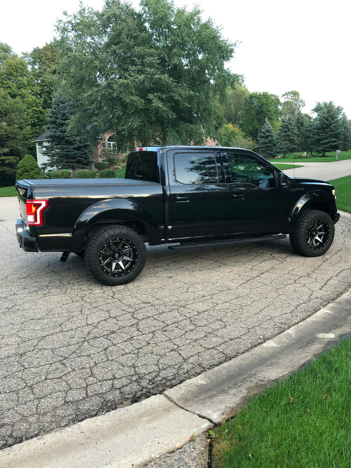 loaded 2015 Ford F 150 XLT lifted