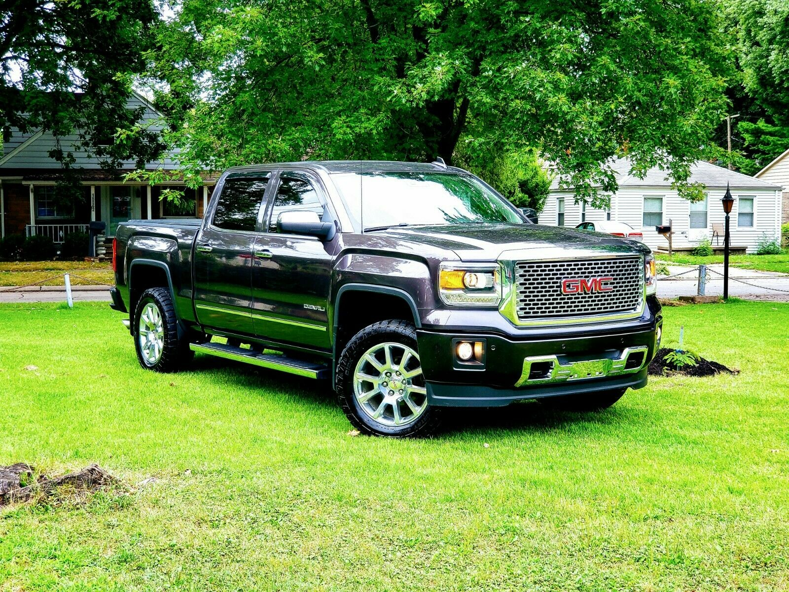 top of the line 2015 GMC Sierra 1500 Denali lifted for sale