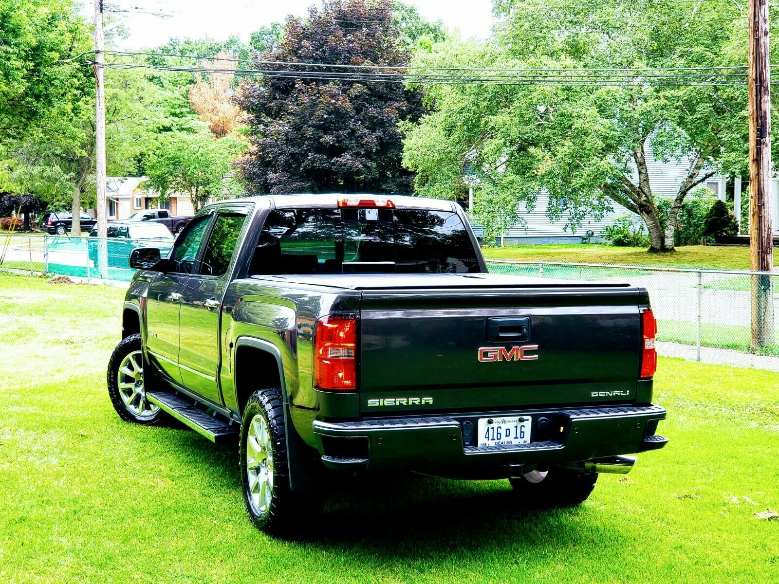 top of the line 2015 GMC Sierra 1500 Denali lifted