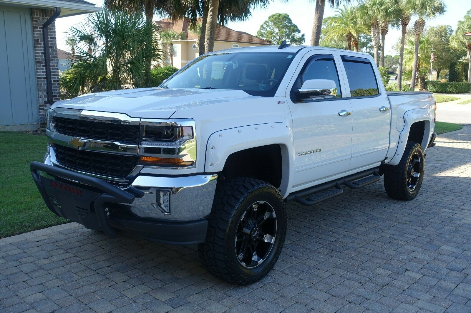clean 2016 Chevrolet Silverado 1500 American Luxury Coach lifted for sale