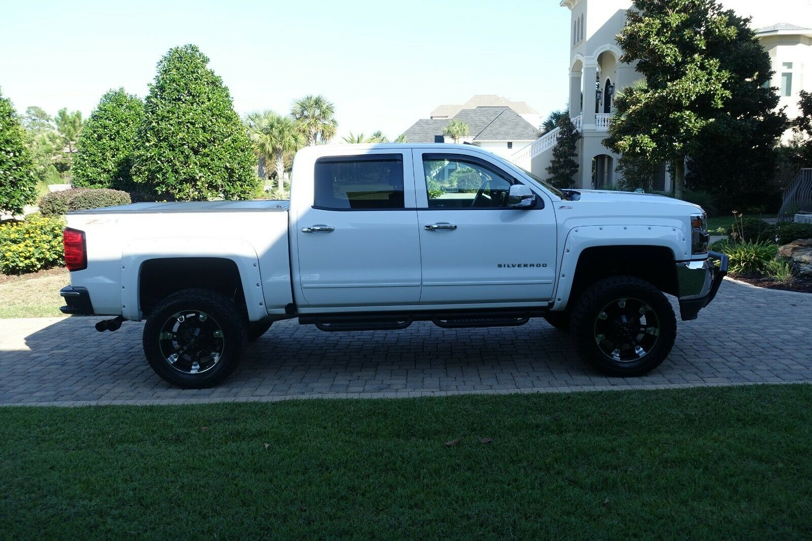 clean 2016 Chevrolet Silverado 1500 American Luxury Coach lifted