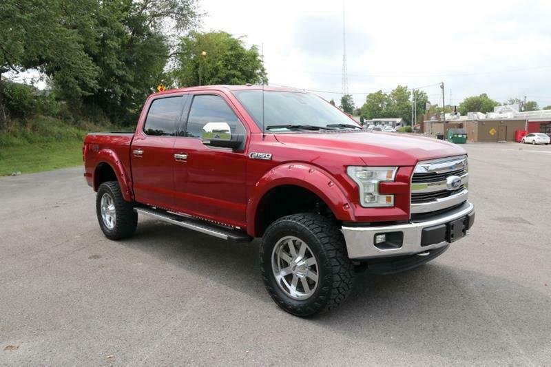 very low miles 2016 Ford F 150 Lariat Supercrew lifted