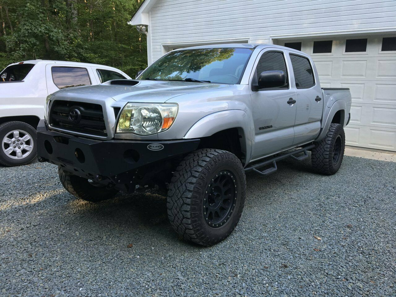 well modified 2007 Toyota Tacoma Double Cab lifted