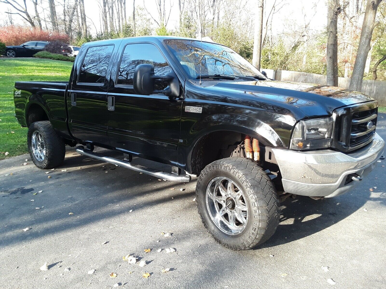 clean 2003 Ford F 250 Lariat lifted