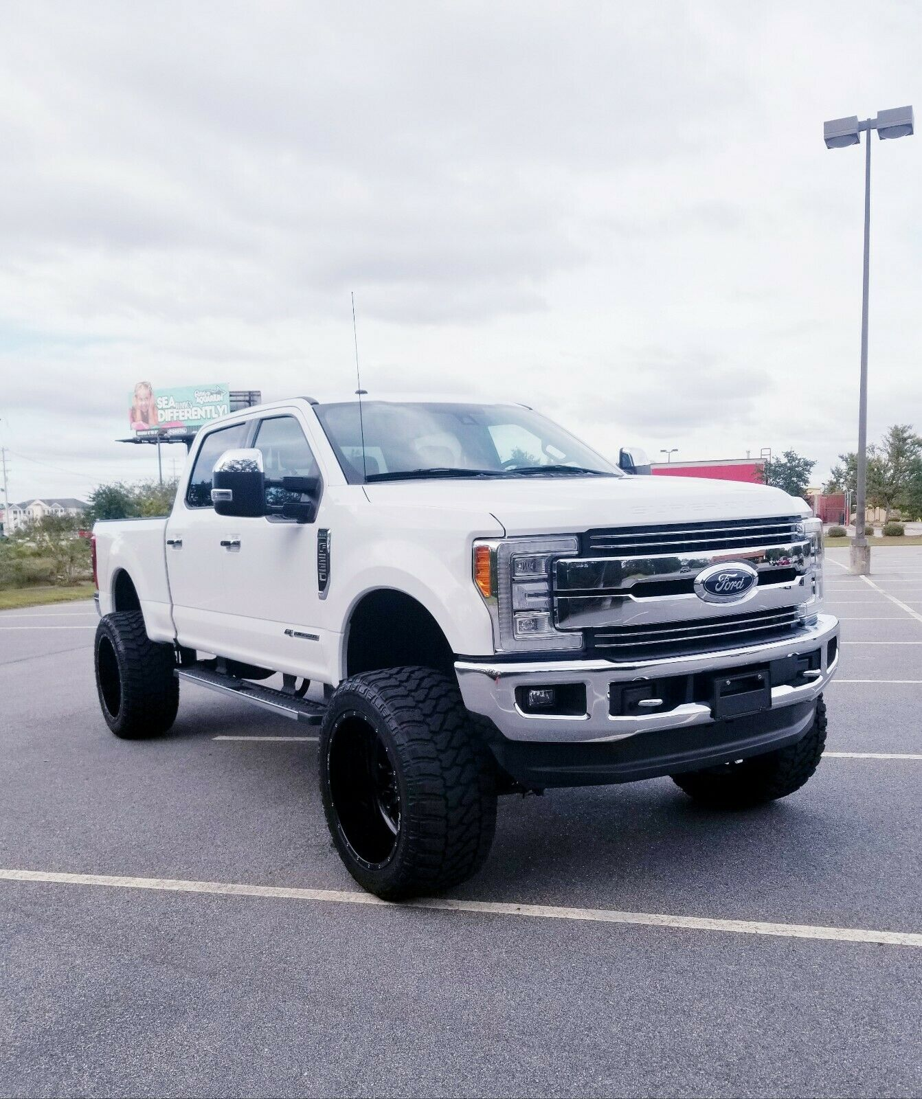 low miles 2017 Ford F 250 LARIAT lifted for sale