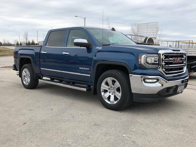 Loaded and low miles 2018 GMC Sierra SLT 1500 lifted for sale