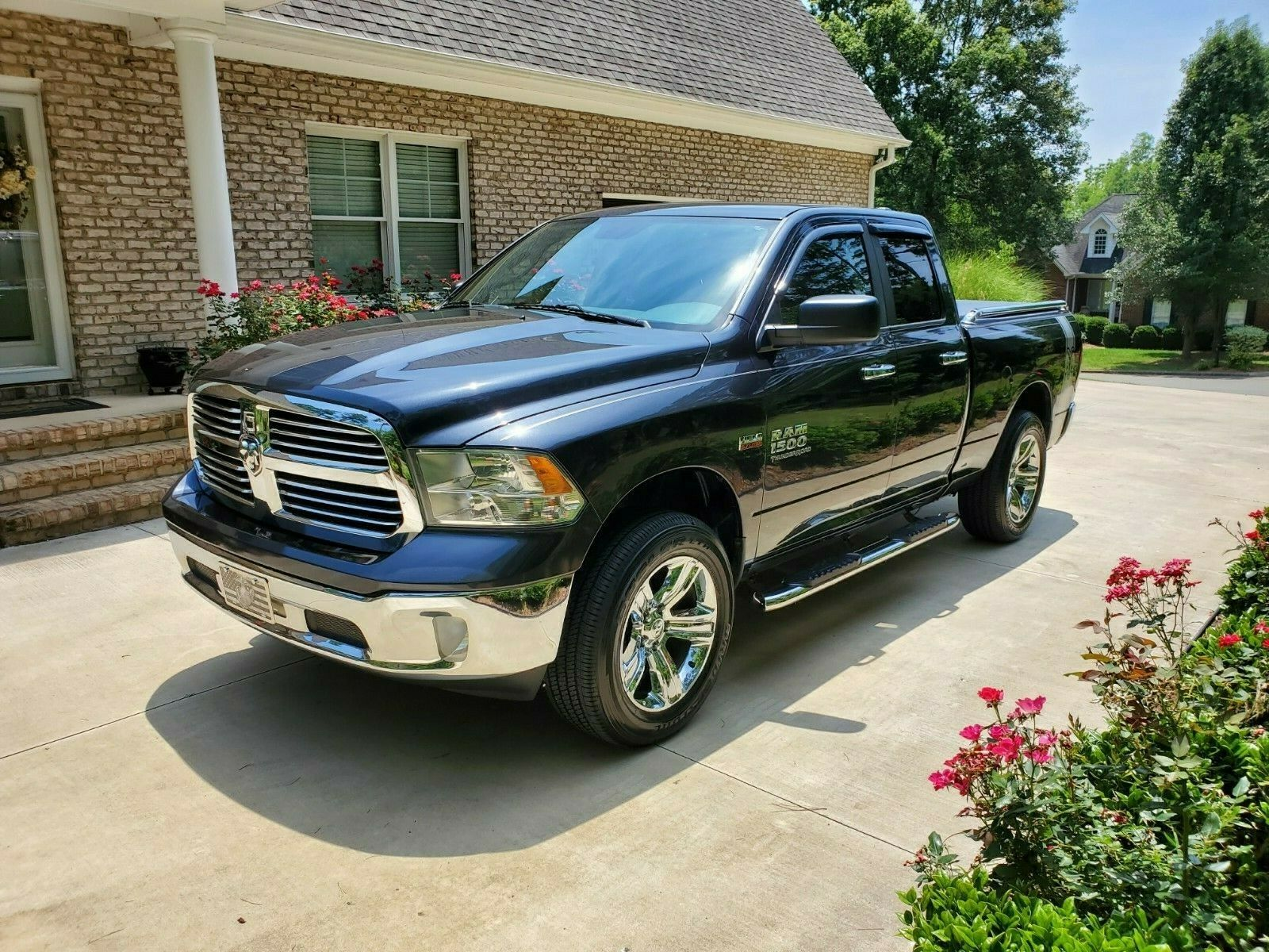very clean 2014 Dodge Ram 1500 SLT lifted